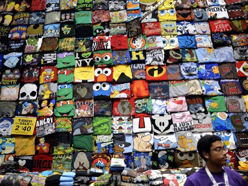 T-shirts on display during the opening session of the 2012 New York Comic Con at the Jacob Javits Center. AFP / Timothy A. Clary