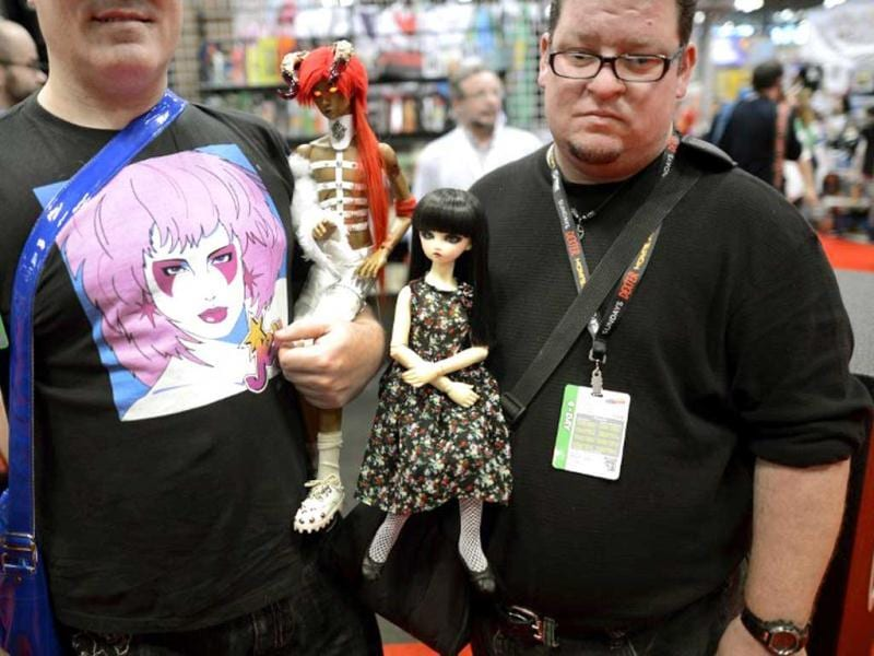 Fans with dolls arrive for the opening session of the 2012 New York Comic Con at the Jacob Javits Center. AFP / Timothy A. Clary