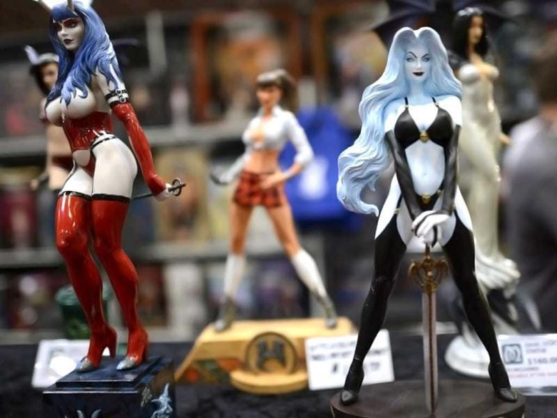 Sexy statues are on display as Fans in costume arrive for the opening session of the 2012 New York Comic Con at the Jacob Javits Center. AFP / Timothy A. Clary