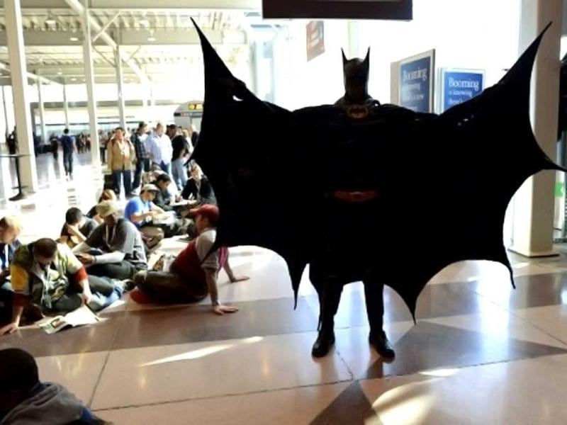 A man dressed as Batman waits with other fans during the opening session of the 2012 New York Comic Con at the Jacob Javits Center. AFP / Timothy A. Clary