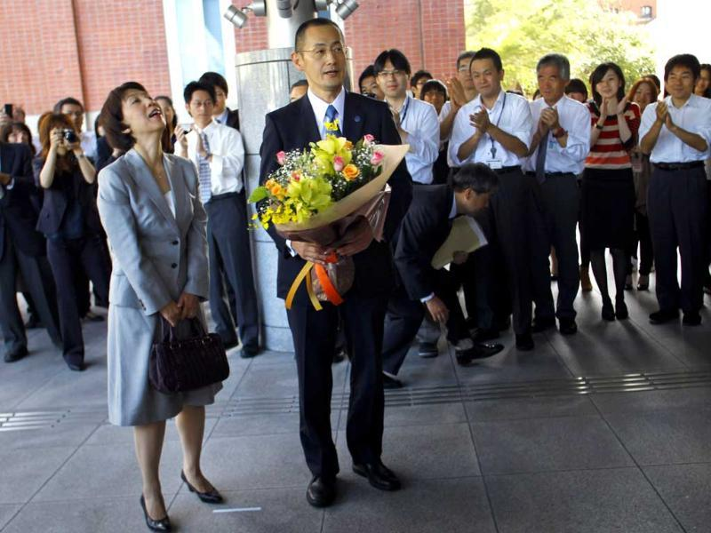 Nobel prize laureate in medicine Shinya Yamanaka of Japan and his wife Chika arrive at Kyoto University for a press conference in Kyoto, western Japan. AP/Junji Kurokawa