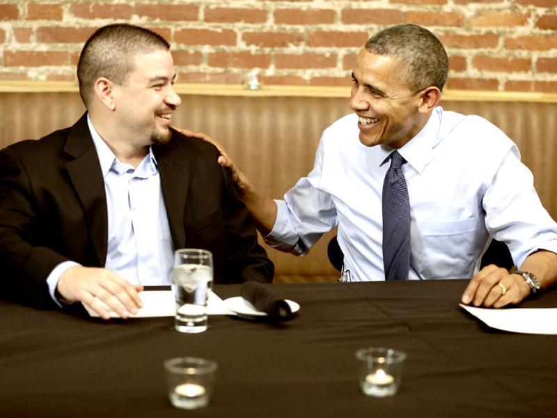 President Barack Obama meets with Mario Orosa, left, of North Canton, Ohio, and other winners of the