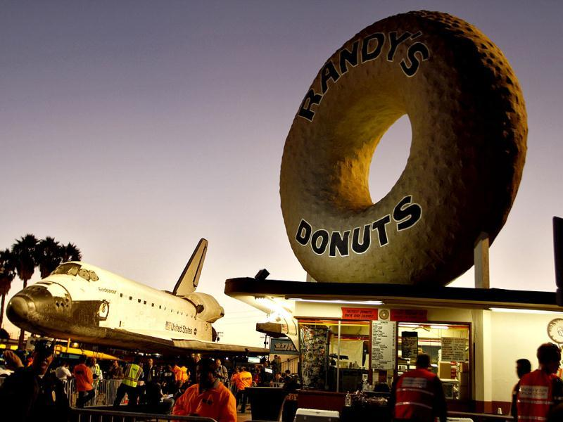 Space Shuttle Endeavour stops in front of Randy's Donuts as it's transported on Manchester Avenue while being moved from Los Angeles International Airport to its retirement home at the California Science Center in Exposition Park in Los Angeles, California. Reuters photo