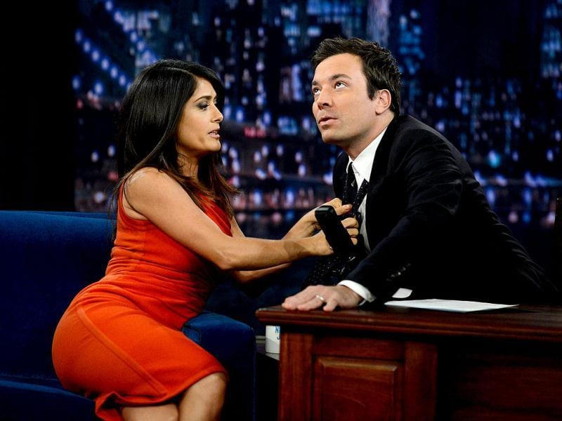 Actress Salma Hayek Pinault helps host Jimmy Fallon with his tie during shooting of Late Night With Jimmy Fallon at Rockefeller Center in New York City. AFP photo