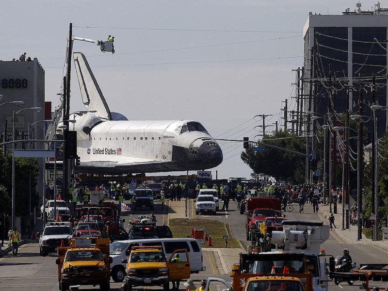 The space shuttle Endeavour slowly moves along city streets on a 160-wheeled carrier in Los Angeles. AP Photo
