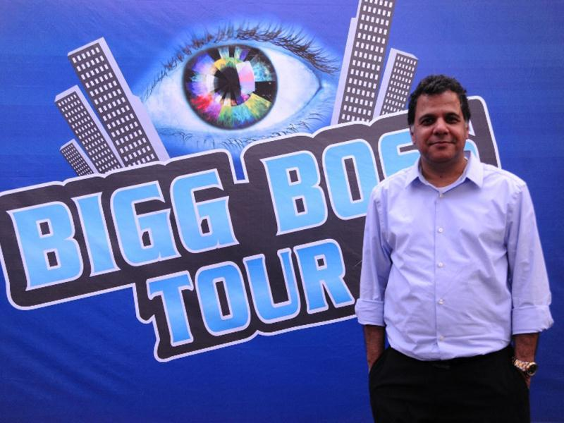 Colors CEO Raj Nayak poses against the Bigg Boss bus