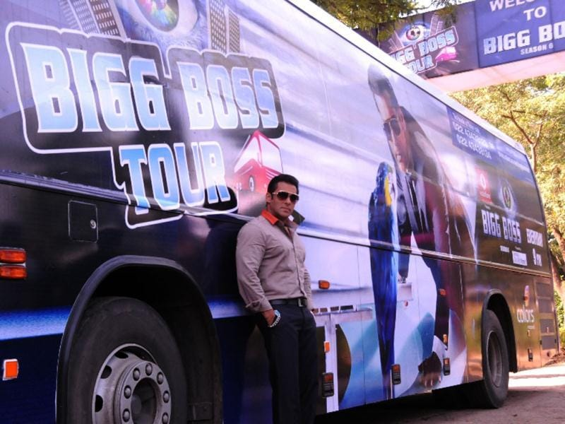 Bigg Boss host Salman Khan stands against the BB Tour bus