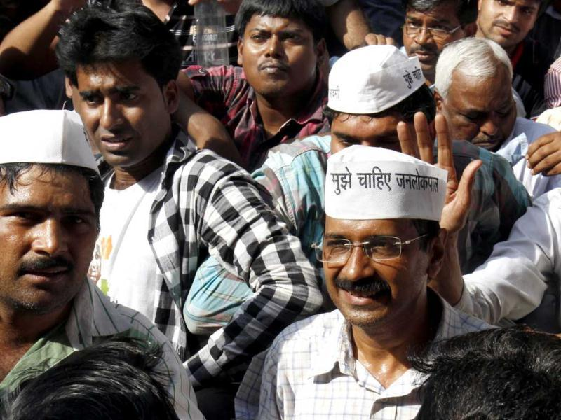 Arvind Kejriwal is seen sitting among his supporters at Parliament Street in New Delhi. HT/Mohd Zakir