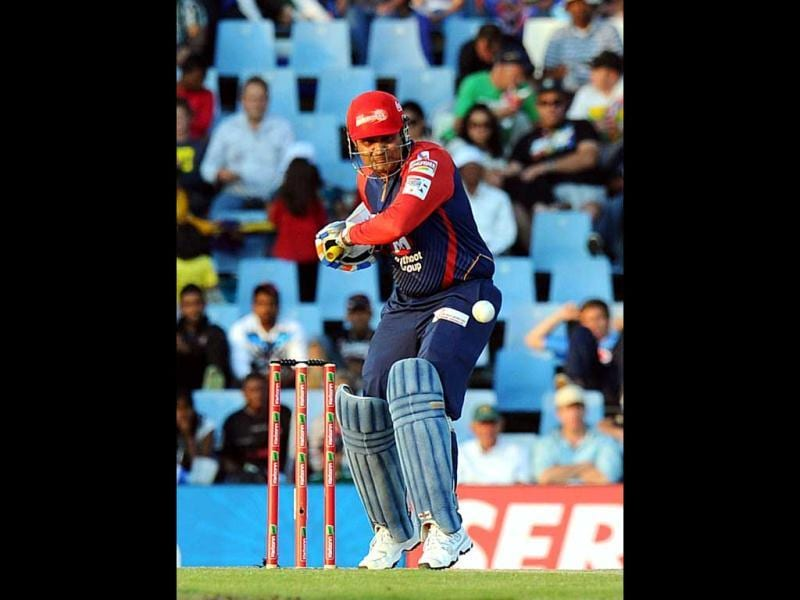 Delhi Daredevils Virender Sehwag plays a shot from Kolkata Knight Riders Brett Lee during a Group A match of the Champions League T20 at Super Sports Park in Centurion. AFP Photo