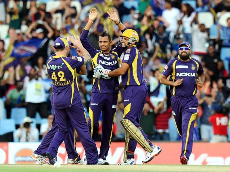 Kolkata Knight Riders cricketer Sunil Narine is congratulated by teammates during a Group A match against the Kolkata Knight Riders in the Champions League T20 at the Super Sports Park in Centurion. AFP Photo