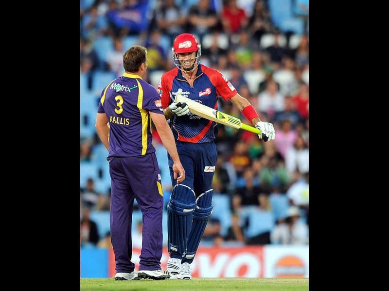 Delhi Daredevils cricketer Kevin Pietersen jokes with Kolkata Knight Riders Jacques Kallis during Group A of the Champions League T20 at Super Sports Park in Centurion. AFP Photo