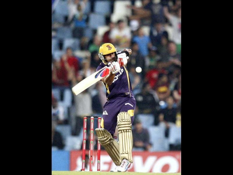 Kolkata Knight Riders's Manoj Tiwary plays a shot from Delhi Daredevils's Umesh Yadav, unseen, during the Champions League Twenty20 cricket match at the Centurion Park in Pretoria. AP Photo