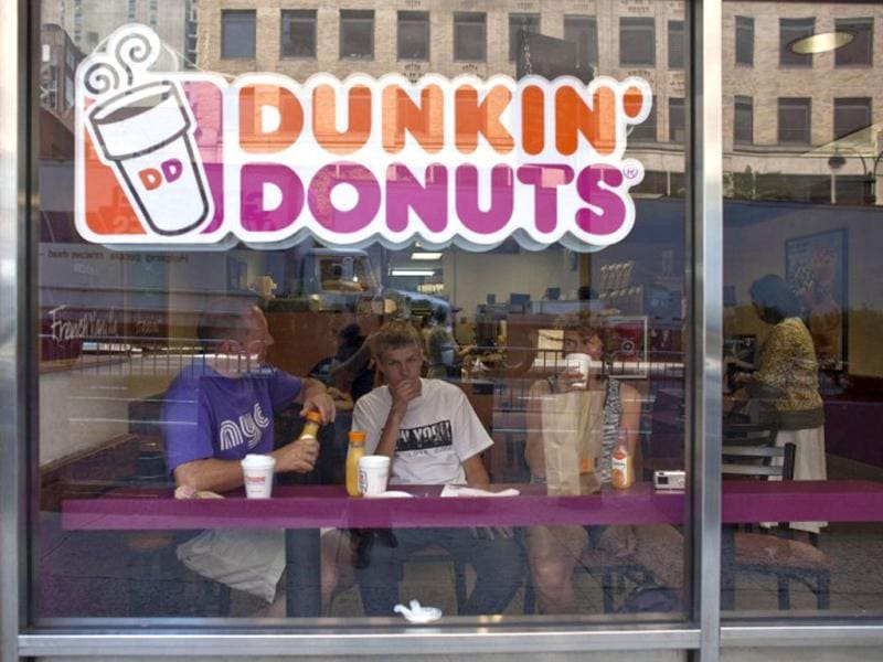File photo of customers at a Dunkin' Donuts store in midtown Manhattan in the New York City. Ramin Talaie/Getty Images/AFP