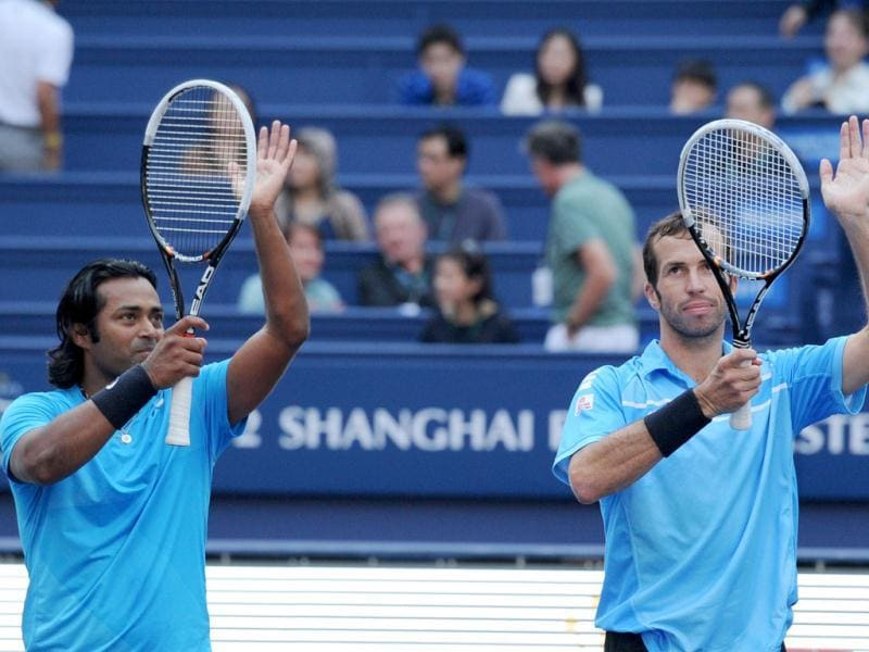 Leander Paes and Radek Stepanek celebrate beating in the doubles final of the Shanghai Masters tennis tournament in Shanghai. AFP Photo