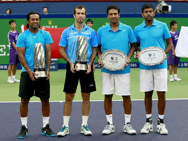 Leander Paes and Radek Stepanek hold the champion trophies as Mahesh Bhupathi and Rohan Bopanna hold their the runner-up trophies in the men's doubles final at the Shanghai Masters tennis tournament in Shanghai. Paes and Stepanek pair won 6-7(7), 6-3, 10-5. AP Photo