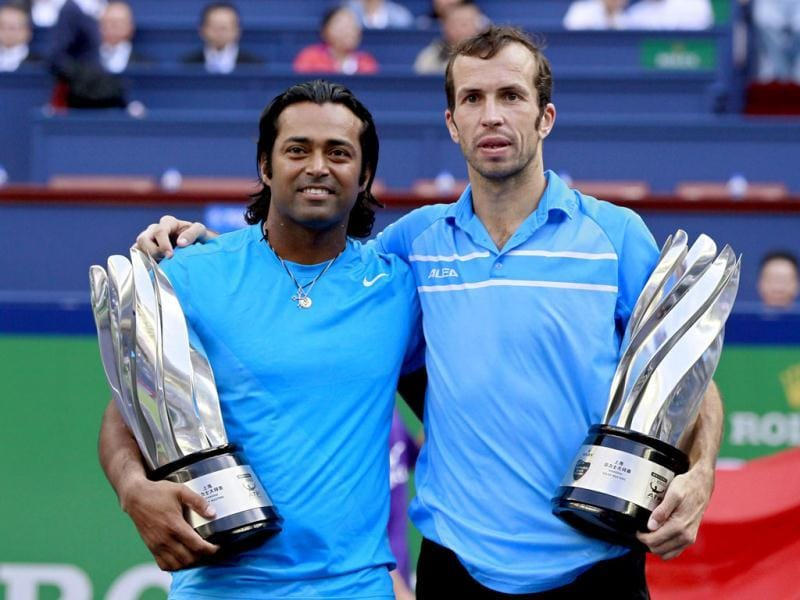 Leander Paes and Radek Stepanek pose with trophies after winning the men's doubles final at the Shanghai Masters tennis tournament. Reuters Photo