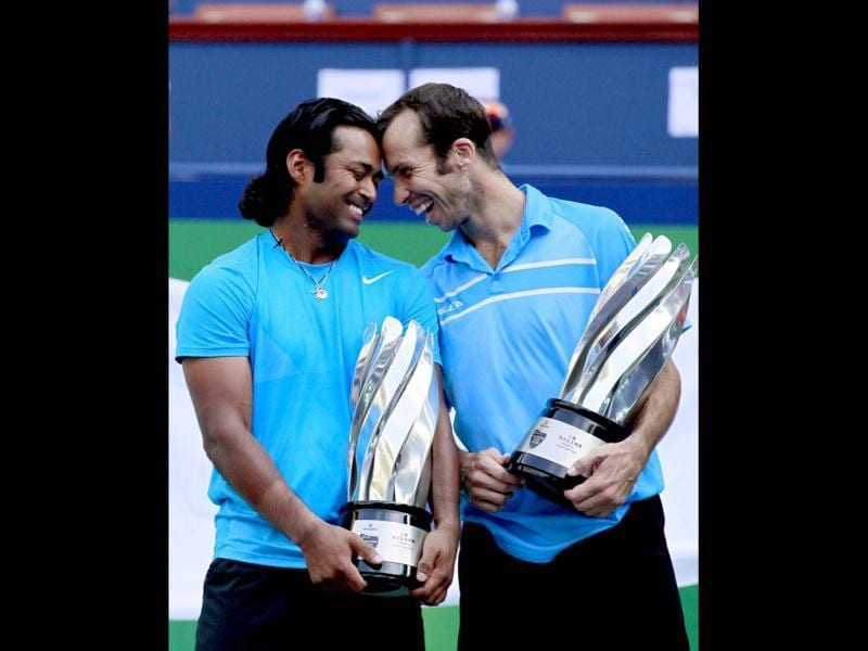Leander Paes and Radek Stepanek pose with their trophies after winning the men's doubles final at the Shanghai Masters tennis tournament. Reuters Photo