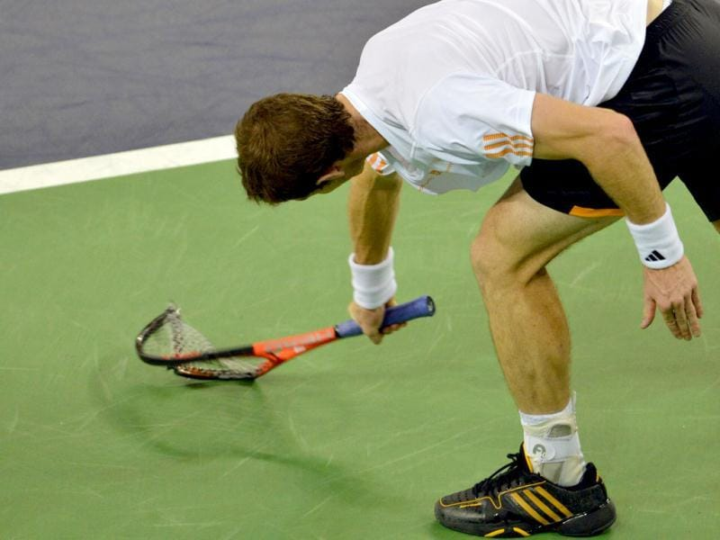 Andy Murray smashes his racket after missing a point against Novak Djokovic during their finals match at the Shanghai Masters tennis tournament in Shanghai. AFP Photo