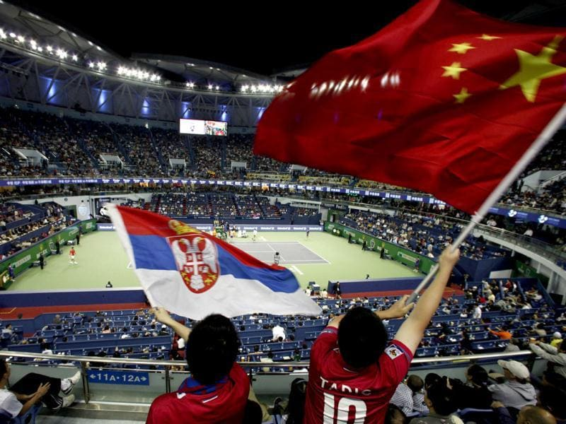 Members of the crowd wave Serbian and Chinese national flags during the men's singles final between Novak Djokovic and Andy Murray at the Shanghai Masters tennis tournament. Reuters Photo