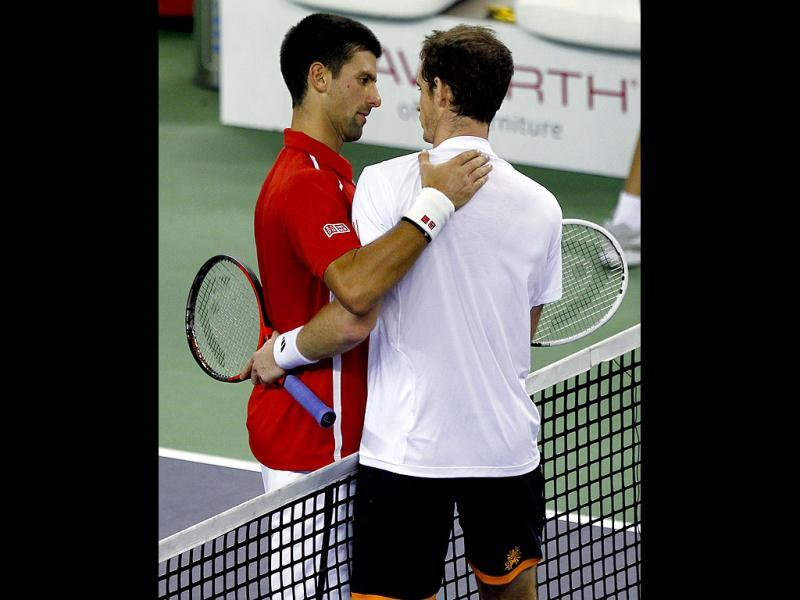 Novak Djokovic is congratulated by Andy Murray after he won the men's singles final at the Shanghai Masters tennis tournament. Reuters Photo