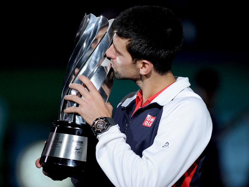 Novak Djokovic kisses the trophy after beating Andy Murray in the final of the Shanghai Masters tennis tournament in Shanghai. AFP Photo