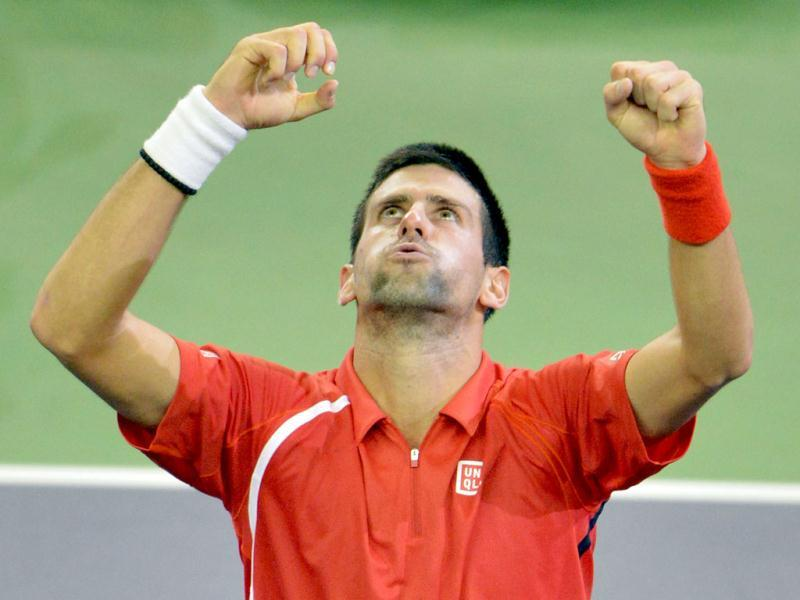 Novak Djokovic of Serbia celebrates after defeating Andy Murray of Britain during their finals match at the Shanghai Masters tennis tournament in Shanghai. Djokovic won 5-7, 7-6, 6-3. AFP Photo