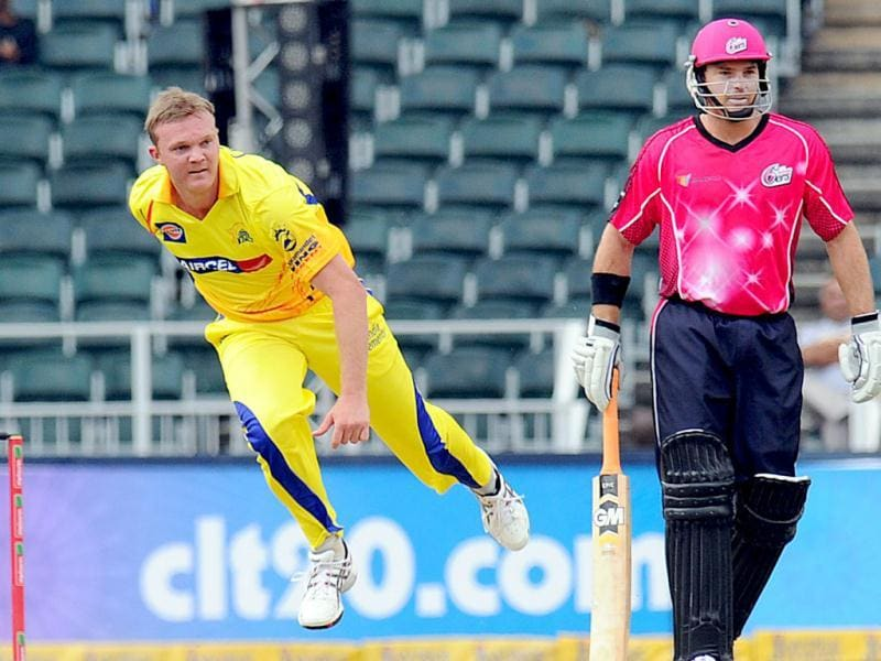 Chennal Super Kings bowler Doug Bollinger jumps next to Sydney Sixers batsman Moises Henriques during a Group B match of the Champions League T20 between the CSK and the Sydney Sixers at the Wanderers Stadium in Johannesburg. AFP photo