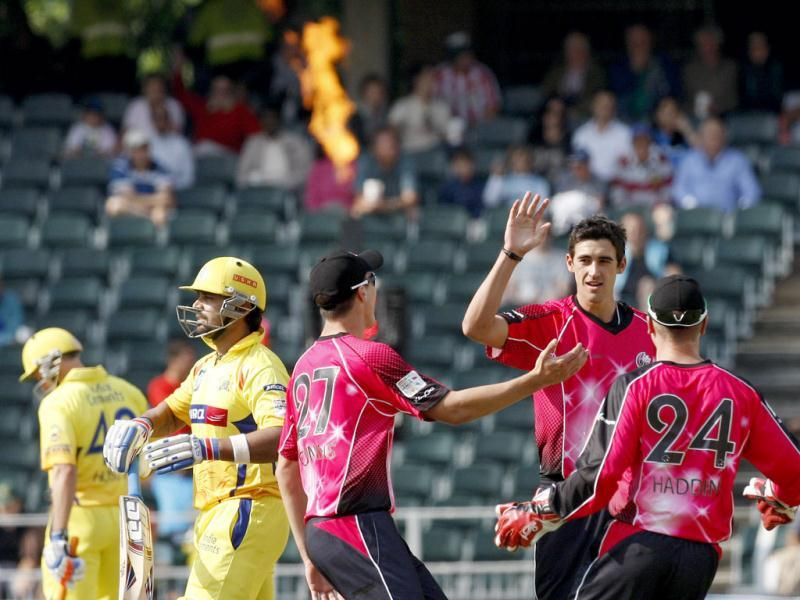 Chennai Super Kings batsman Murali Vijay leaves the field after being bowled by Sydney Sixers bowler Mitchell Starc for 1 run during the Champions League Twenty20 cricket match at the Wanderers Stadium, Johannesburg. AP photo