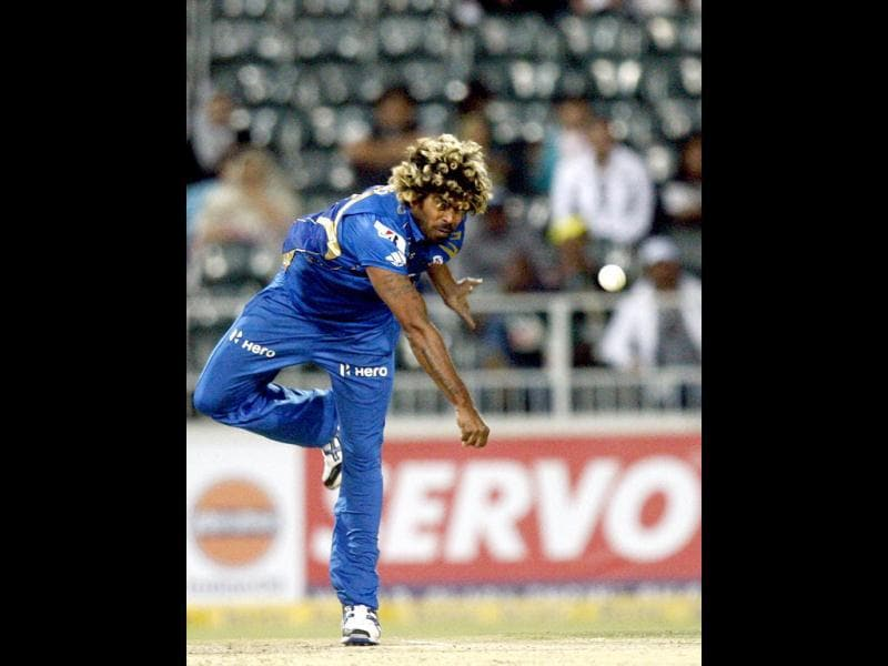 Mumbai Indians bowler Lasith Malinga in delivery against Highveld Lions captain Alviro Petersen, unseen, during the Champions League Twenty20 cricket match at the Wanderers Stadium, Johannesburg. (AP Photo/Themba Hadebe)