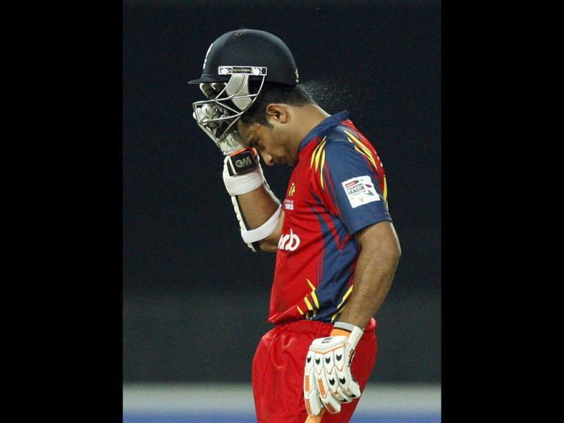 Highveld Lions batsman Gulam Bodi takes off his helmet after a dismissal by Mumbai Indians bowler Harbhajan Singh, unseen, for 19 runs during the Champions League Twenty20 cricket match at the Wanderers Stadium, Johannesburg. (AP Photo/Themba Hadebe)