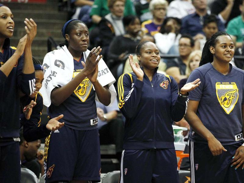 Indiana Fever center Tammy Sutton-Brown, center Jessica Davenport, guard Karima Christmas and center Sasha Goodlett cheer on their team in the second half of Game 1 of the WNBA basketball Finals against the Minnesota Lynx in Minneapolis. AP/Stacy Bengs