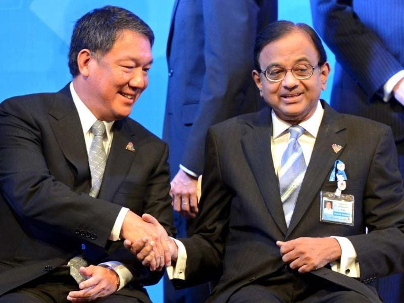 Thai finance minister Kittiratt Na-Ranong shakes hands with P Chidambaram during the opening ceremony of 10th Asia-Europe Finance Minister's Meeting 2012 in Bangkok. AFP/Pornchai Kittiwongsakul