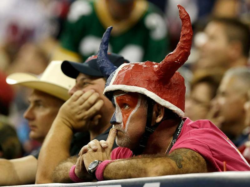 Houston Texan fans watch the play in the fourth quarter during their game against the Green Bay Packers at Reliant Stadium in Houston, Texas. AFP/Scott Halleran
