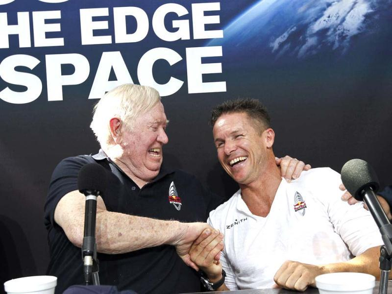 Felix Baumgartner shares a laugh with Col Joe Kittinger, USAF retired, after successfully jumping from a space capsule lifted by a helium balloon at a height of just over 128,000 feet above the Earth's surface, beating Kittinger's old record of 102,799 ft. AP/Ross D Franklin