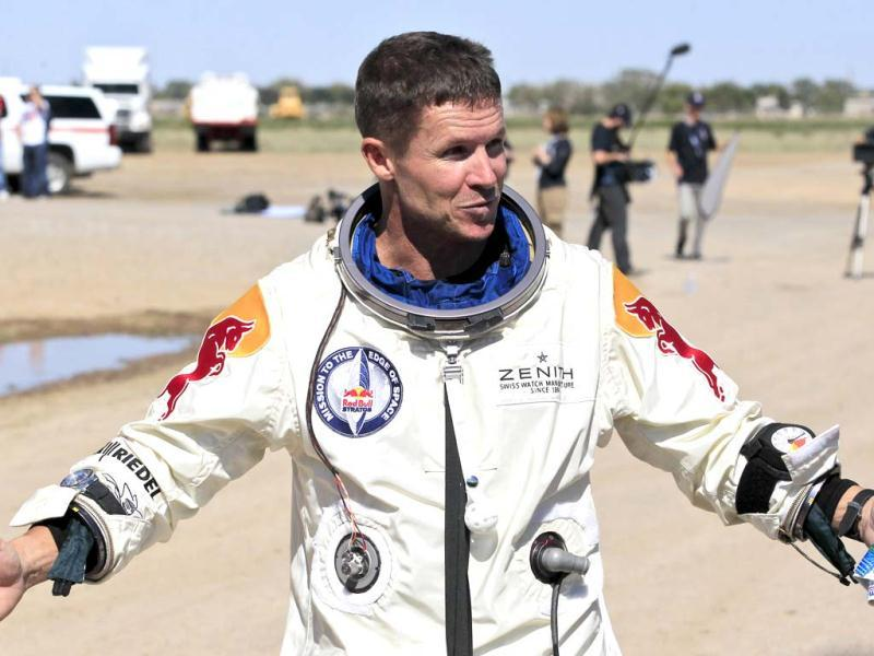 Felix Baumgartner gestures prior to speaking with the media after successfully jumping from a space capsule lifted by a helium balloon at a height of just over 128,000 feet above the Earth's surface. AP/Ross D Franklin