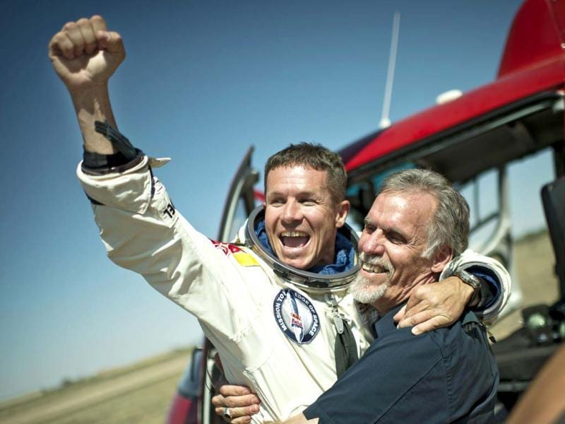 Felix Baumgartner and technical project director Art Thompson of the US celebrate after Baumgartner successfully completed the final manned flight for Red Bull Stratos in Roswell, New Mexico. Reuters