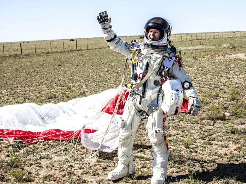 In this photo provided by Red Bull Stratos, Felix Baumgartner celebrates after successfully completing the final manned flight for Red Bull Stratos. AP/Red Bull Stratos, Balazs Gardi