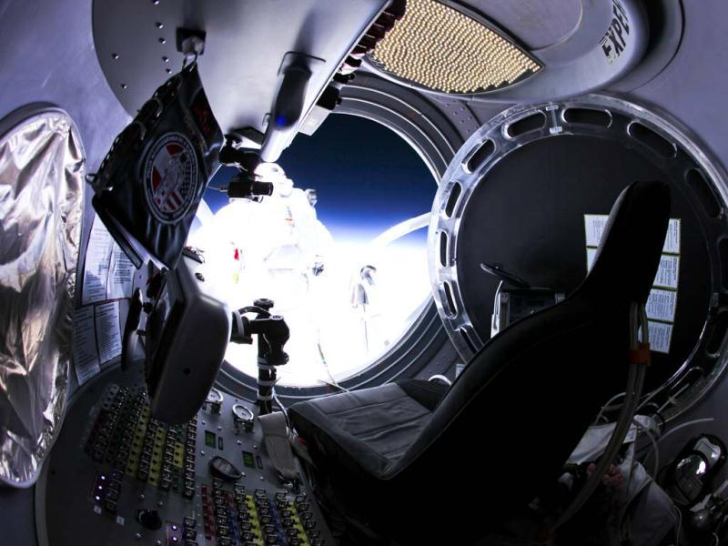 This photo provided by Red Bull Stratos shows Felix Baumgartner as he jumps out of the capsule during the final manned flight for Red Bull Stratos. AP/Red Bull Stratos, Jay Nemeth