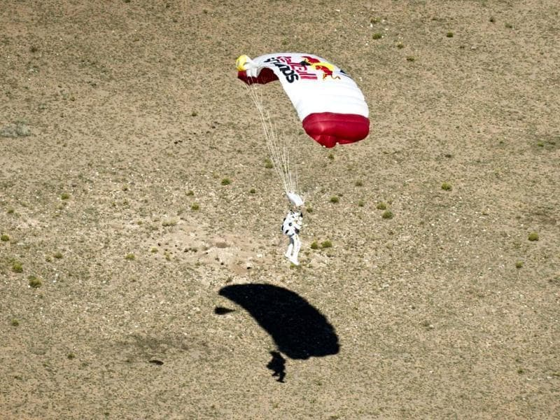 Felix Baumgartner lands in the desert after completing the final manned flight for Red Bull Stratos in Roswell, New Mexico. Reuters/Red Bull Handout