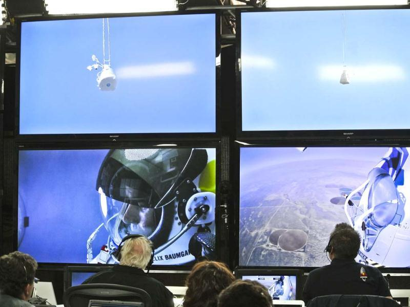 In this photo provided by Red Bull, Felix Baumgartner is seen in a screen at mission control center in the capsule during the final manned flight for Red Bull Stratos in Roswell, New Mexico. AP/Red Bull Stratos