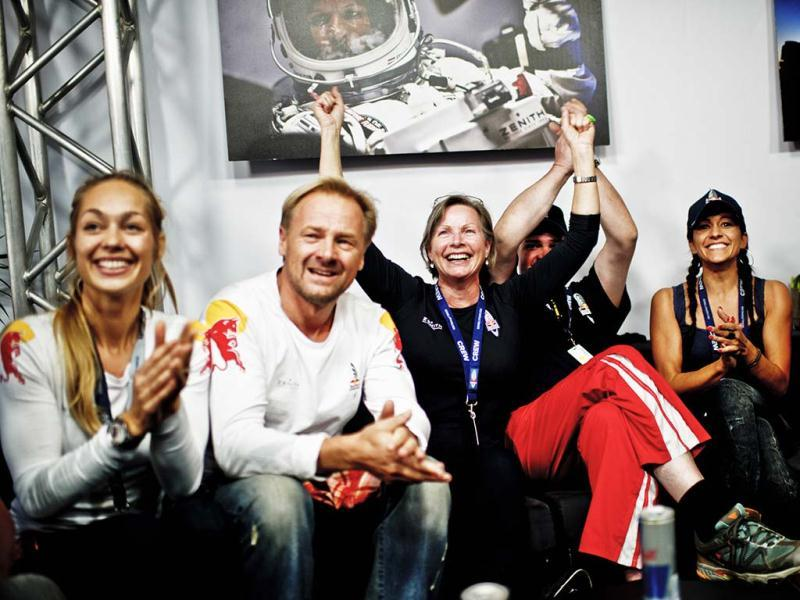 This picture provided by www.redbullcontentpool.com shows family members and friends celebrating the successful jump of Felix Baumgartner aboard Red Bull Stratos in Roswell, New Mexico. AFP/Red Bull Handout