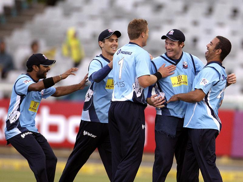 Auckland Aces team members react with Michael Bates, center, as they take the wicket of Kolkata Knight Gautam Gambhir, unseen, during the Champions League Twenty20 cricket game in Cape Town, South Africa. AP Photo/Schalk van Zuydam