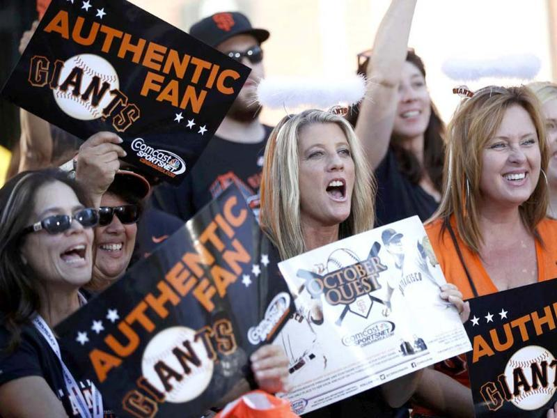 San Francisco Giants fans cheer before the start of Game 2 of the MLB NLCS playoff baseball series against the St. Louis Cardinals in San Francisco. Reuters/Stephen Lam