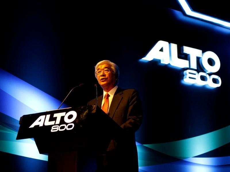 Shinzo Nakanishi (L), Managing Director and CEO of Maruti Suzuki India with Mayank Pareek (2ndL), Executive Officer, Marketing and Sales, Maruti Suzuki India, addressing the press during the launch of the company's new 'Alto 800' in New Delhi. (PTI Photo by Vijay Kumar Joshi)