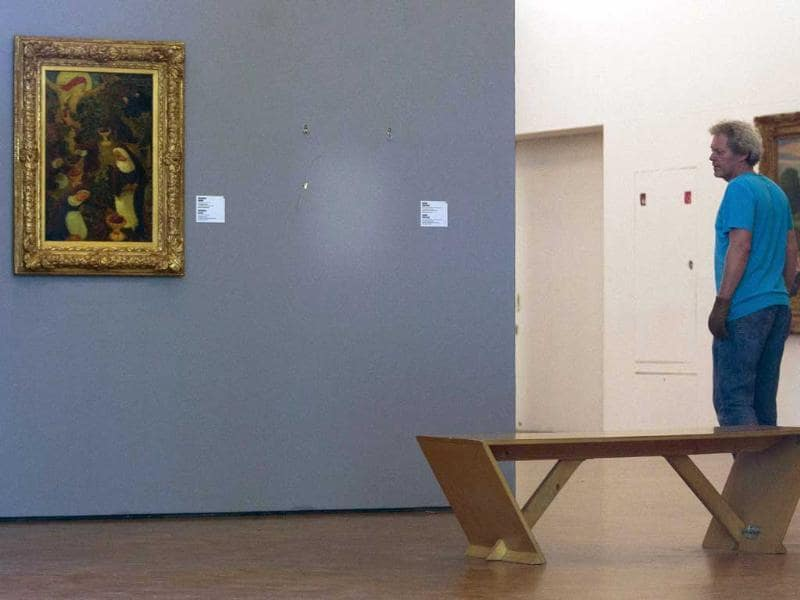 A man pauses to look at the empty space where Henri Matisse' painting