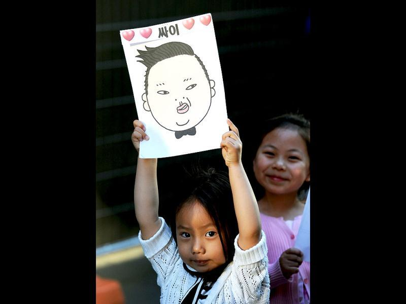A young fan waits for the arrival of South Korean pop sensation Psy, whose real name is Park Jae-Sang, who was scheduled to perform for fans at a promotion by the Sunrise television breakfast show in central Sydney. AFP/Greg Wood