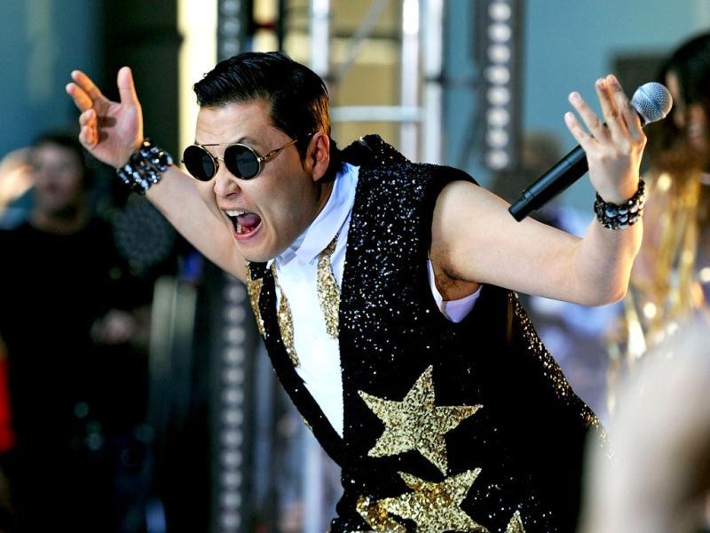 South Korean pop sensation Psy, whose real name is Park Jae-Sang, performs for fans at a promotion by the Sunrise breakfast television show in central Sydney. AFP /Greg Wood