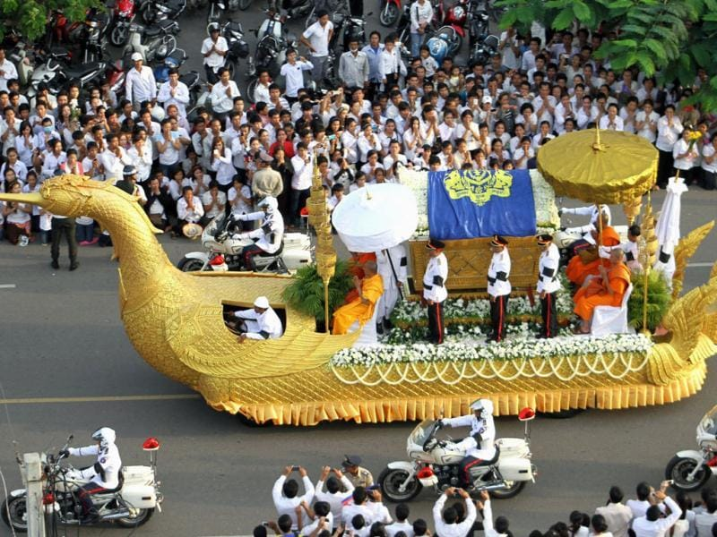 A phoenix float with the casket carrying the body of former Cambodian King Norodom Sihanouk proceeds as mourners line up a street to pay their respects in Phnom Penh, Cambodia. AP Photo