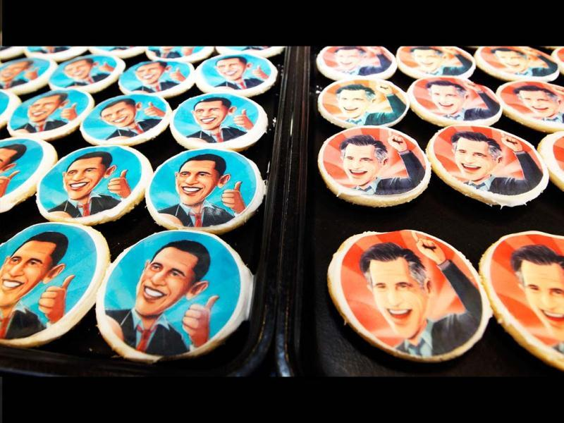 Platters of sugar cookies bearing the likenesses of President Barack Obama, left, and Republican presidential candidate Mitt Romney, are available for sale on the counter at the Oakmont Bakery in Oakmont, Pa. (AP Photo)