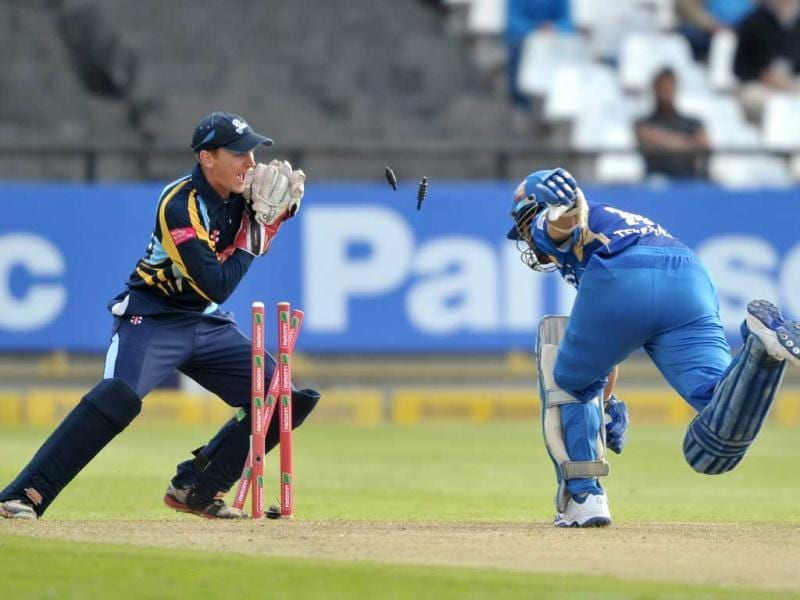 Dan Hodgson of Yorkshire Carnegie stumps Sachin Tendulkar of the Mumbai Indians during Match 11 of The Champions League T20 (CLT20) between the Mumbai Indians (India) and Yorkshire (England) at Newlands Cricket Stadium in Cape Town. AFP Photo/Luigi Bennett